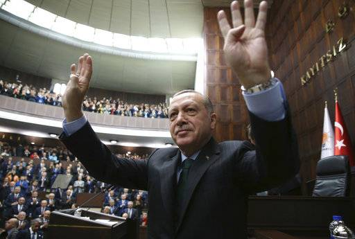 Turkey's President Recep Tayyip Erdogan waves as he arrives to deliver a speech during a meeting of his ruling Justice and Development Party (AKP), in Ankara, Turkey, Tuesday, Dec. 5, 2017. Erdogan says U.S. recognition of Jerusalem as Israel's capital is a 'red line' for Muslims and also said such a step would lead Turkey to cut off all diplomatic ties with Israel. (Yasin Bulbul/Pool via AP)