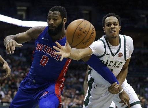 Detroit Pistons' Andre Drummond and Milwaukee Bucks' John Henson go after a loose ball during the first half of an NBA basketball game Wednesday, Dec. 6, 2017, in Milwaukee.
