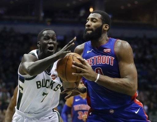 Milwaukee Bucks' Thon Maker fouls Detroit Pistons' Andre Drummond during the first half of an NBA basketball game Wednesday, Dec. 6, 2017, in Milwaukee.