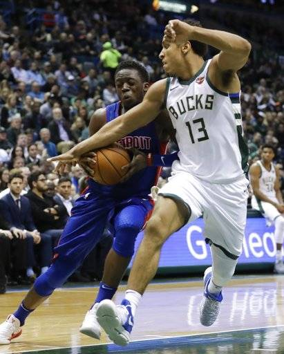 Detroit Pistons' Reggie Jackson tries to drive past Milwaukee Bucks' Malcolm Brogdon during the first half of an NBA basketball game Wednesday, Dec. 6, 2017, in Milwaukee.