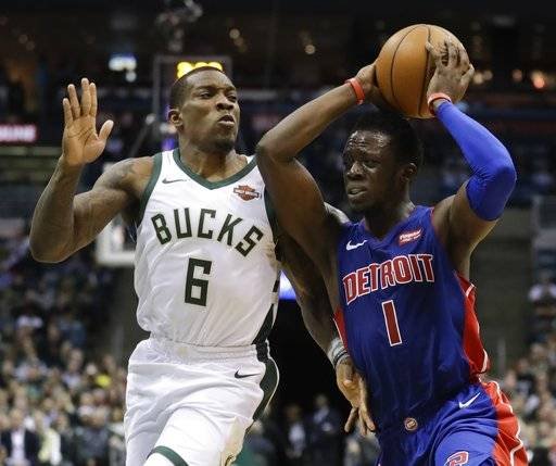 Detroit Pistons' Reggie Jackson tries to drive past Milwaukee Bucks' Eric Bledsoe during the first half of an NBA basketball game Wednesday, Dec. 6, 2017, in Milwaukee.