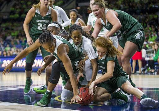 Michigan State's Shay Colley, left, and Taryn McCutcheon, right, compete with Notre Dame's Lili Thompson, center, for a loose ball during the second half of an NCAA college basketball game Wednesday, Dec. 6, 2017, in South Bend, Ind. Notre Dame won 90-59.