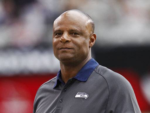 "FILE - In this Sept. 9, 2012, file photo, Warren Moon walk along the sideline prior to an NFL football game between the Seattle Seahawks and the Arizona Cardinals in Glendale, Ariz. Hall of Fame quarterback Moon has been accused of sexual harassment by an assistant for his sports marketing firm, according to a lawsuit filed in California. The civil lawsuit was filed Monday, Dec. 4, 2017, in Orange County Superior Court. According to court documents, Wendy Haskell alleges Moon made ""unwanted and unsolicited"" sexual advances as part of her role as his assistant working for Sports 1 Marketing. Moon is the co-founder and president of the company."