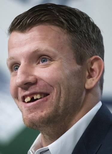 Derek Dorsett, who had to retire from playing professional hockey with the Vancouver Canucks recently due to medical reasons, smiles while speaking during a news conference in Vancouver, British Columbia, Wednesday, Dec. 6, 2017. (Darryl Dyck/The Canadian Press via AP)