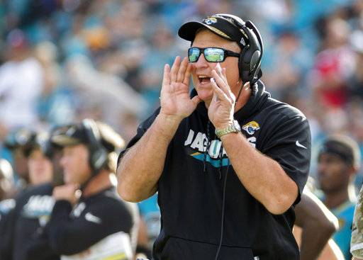 FILE - In this Nov. 5, 2017, file photo, Jacksonville Jaguars head coach Doug Marrone shouts a players from the sidelines during the second half of an NFL football game against the Cincinnati Bengals in Jacksonville, Fla. After coach Marrone disclosed his love of bologna and cheese sandwiches, the National Hot Dog and Sausage Council sent 100 logs of beef bologna to the stadium.