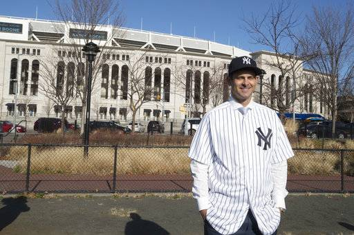 New York Yankees new baseball manager Aaron Boone poses outside Yankee Stadium after an introductory news conference Wednesday, Dec. 6, 2017, at Yankee stadium in New York.