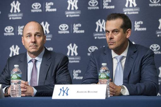 New York Yankees new manager Aaron Boone, right, sits with general manager Brian Cashman during a baseball news conference introducing Boone, Wednesday, Dec. 6, 2017, at Yankee stadium in New York.
