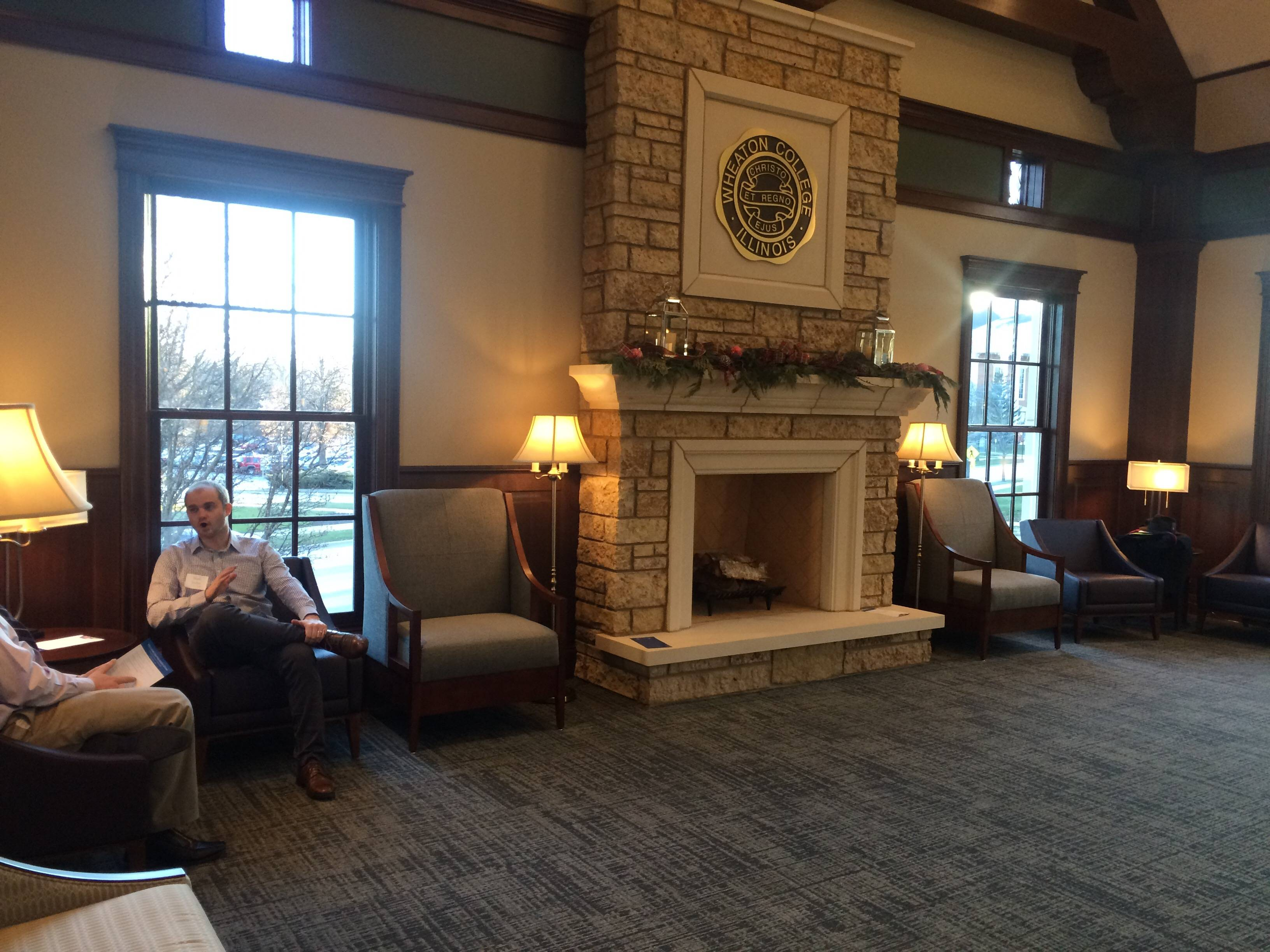 "The center's ""Great Hall"" is an inviting space with a fireplace, cozy furniture and views of historic campus buildings."