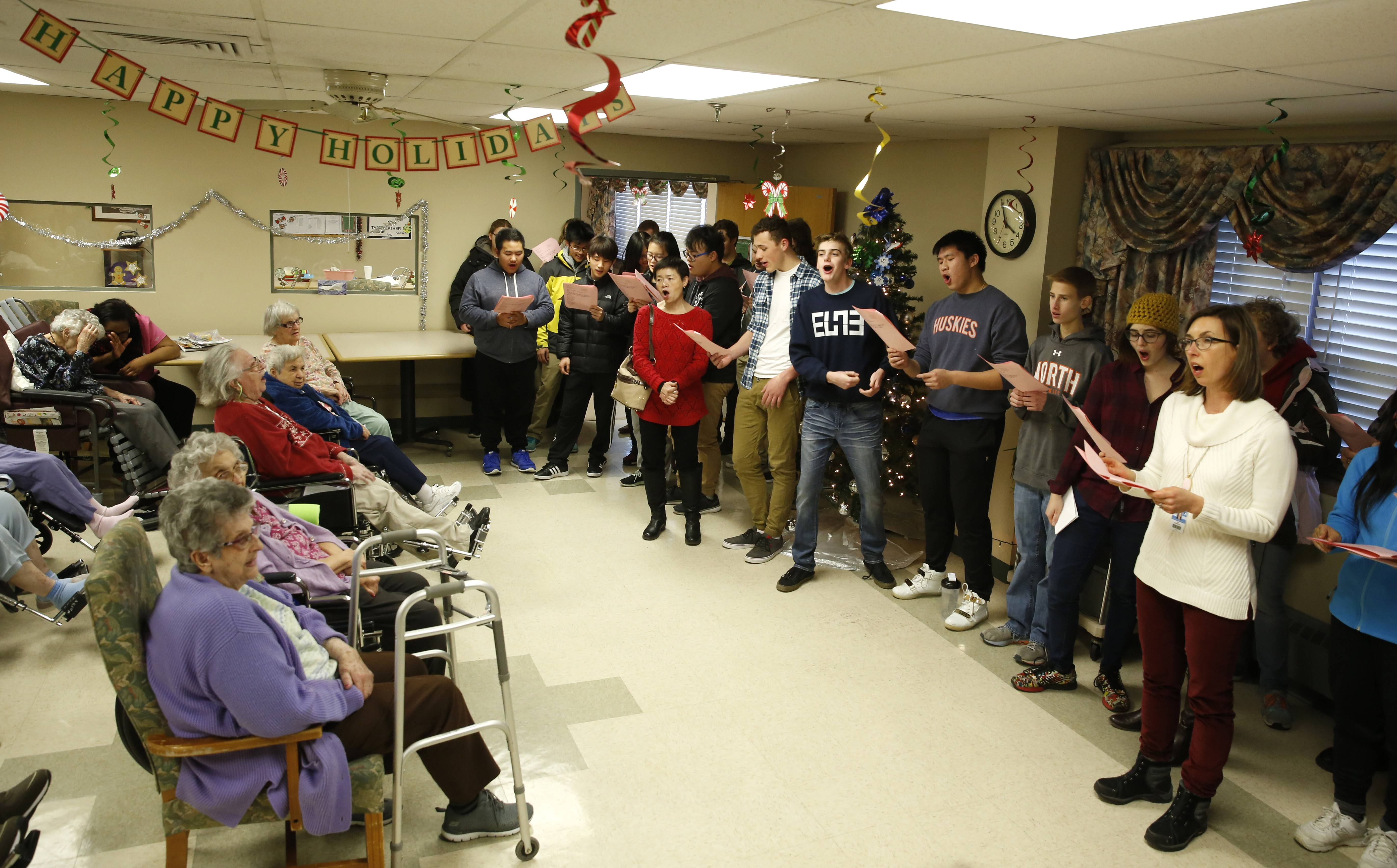 Naperville North students taking classes in foreign languages sing holiday carols in Latin, German, Chinese, Spanish, Italian and French to residents at Community Nursing and Rehab in Naperville.