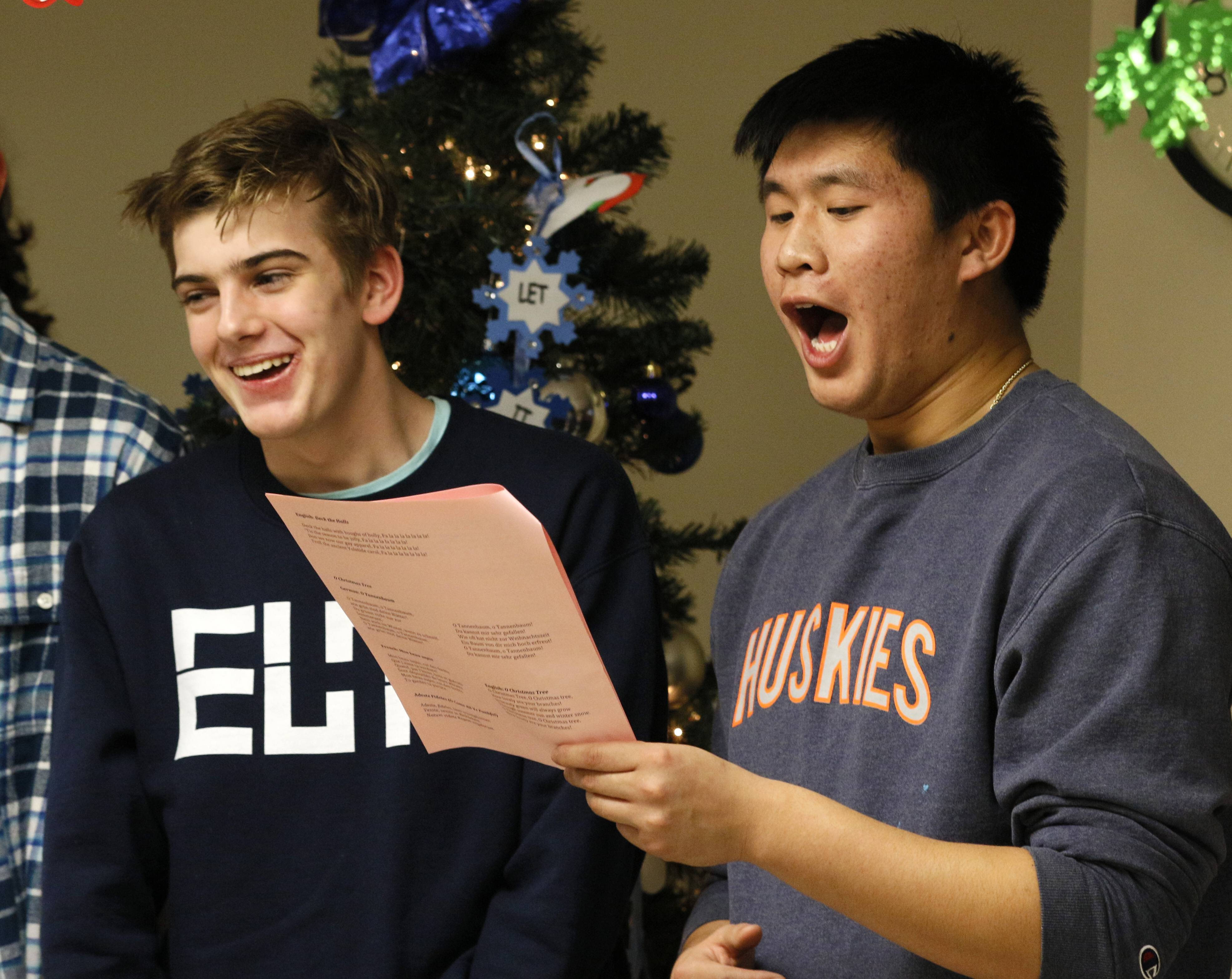 Naperville North students Liam Moore, left, and Ryan Fang sing carols to residents at Community Nursing and Rehab in Naperville.