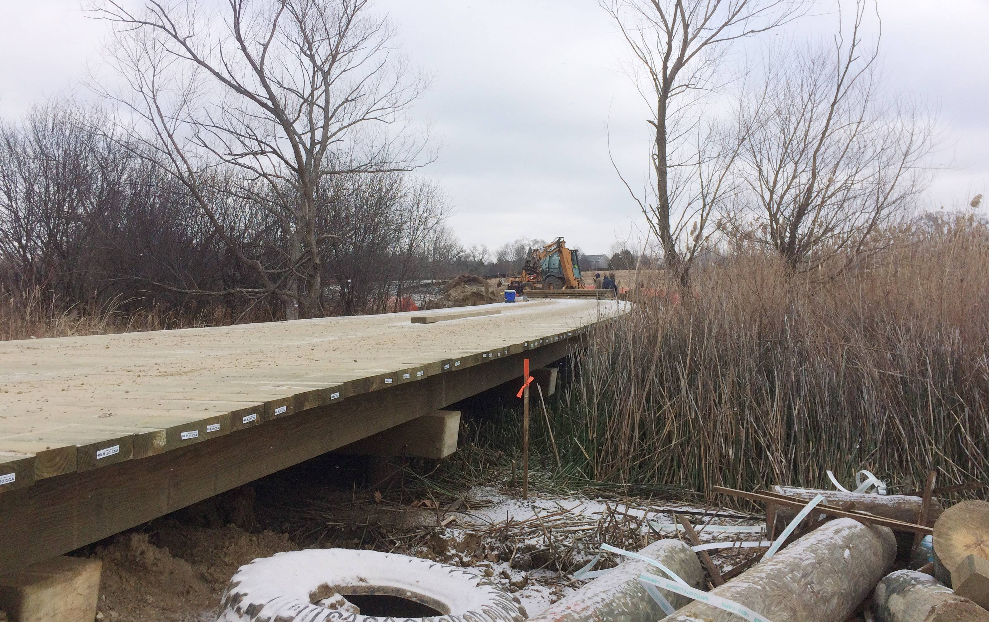 Construction of a boardwalk that's part of a connection from Cedar Lake Road to the Nippersink Forest Preserve trail system near Round Lake is nearly complete.