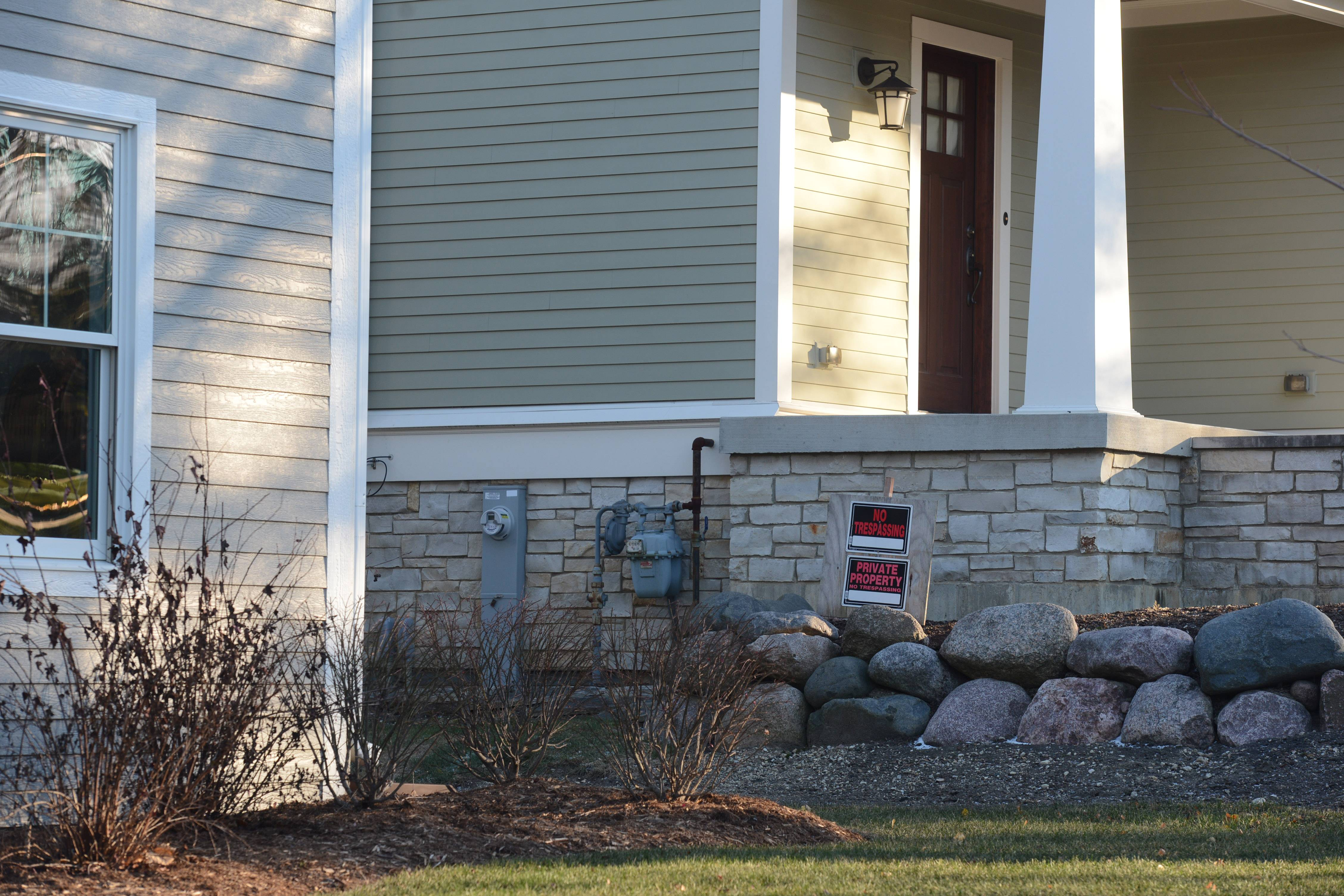 Barrington resident Karen McCarthy filed a federal lawsuit claiming village government allowed her neighbors to build a home that's too big and in violation of local law. Signs warn her neighbors to keep off her property.