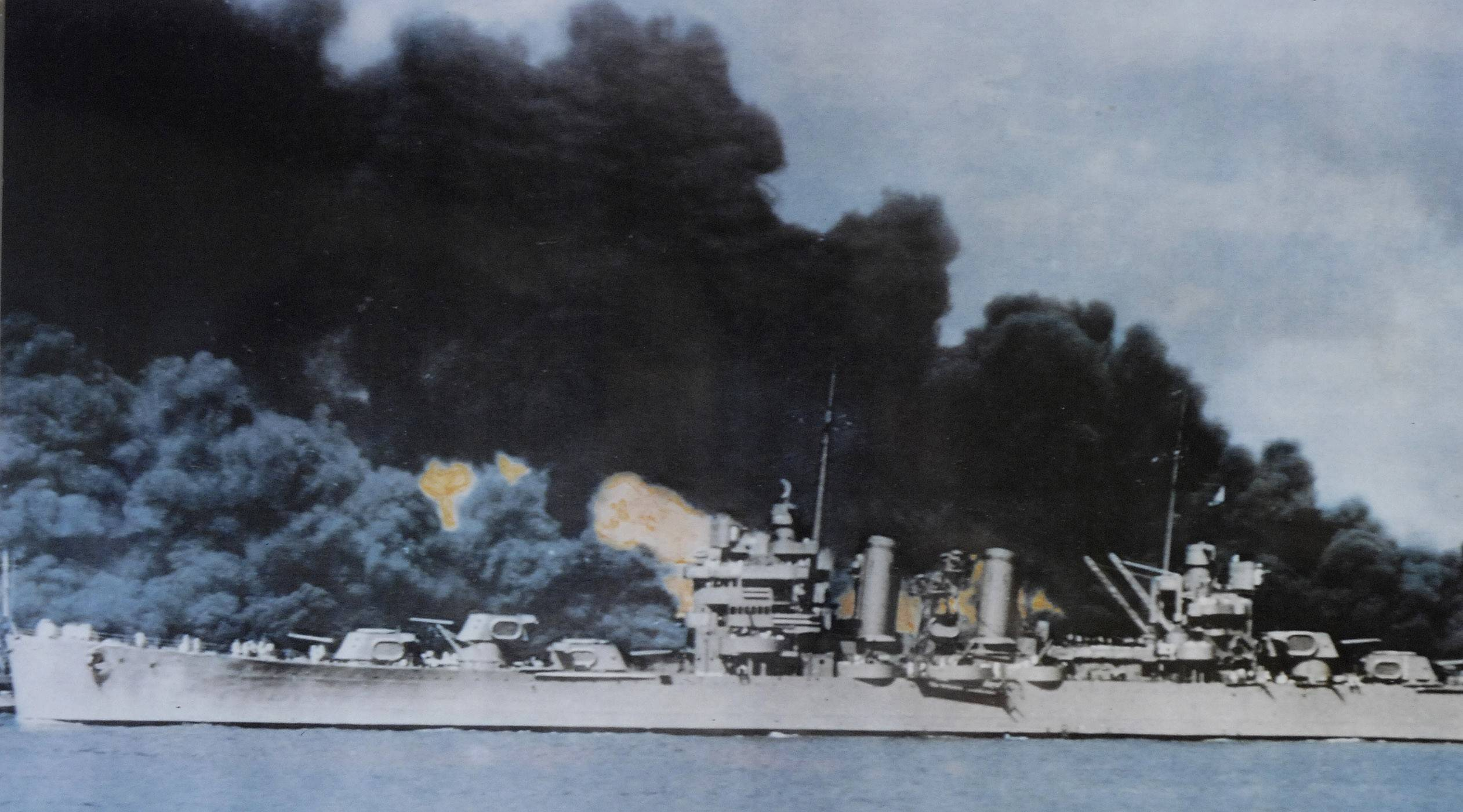 U.S.S. Phoenix passes the burning U.S.S. Arizona in Pearl Harbor after the surprise attack by the Japanese December 7, 1941.