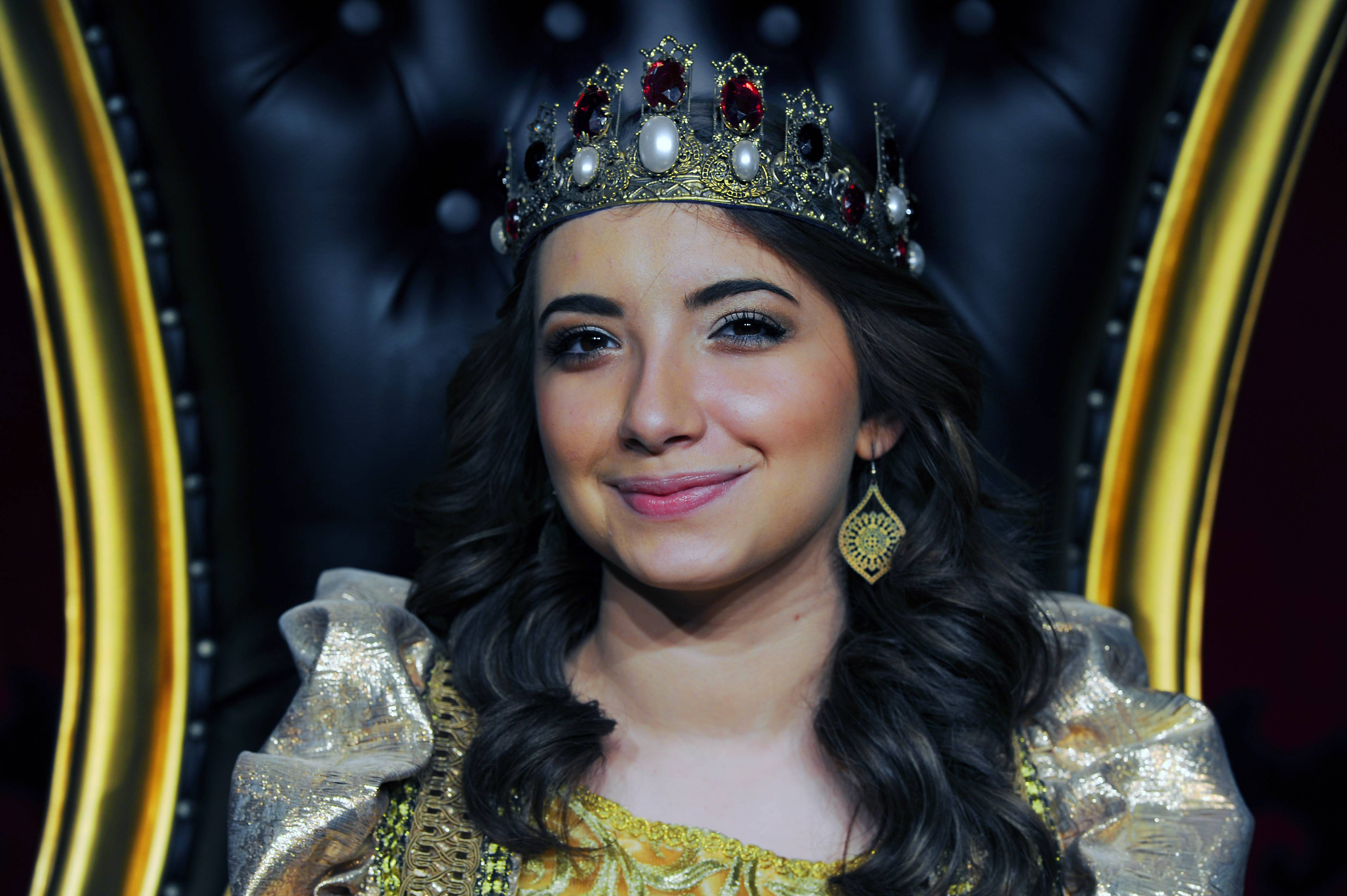 Sara Schubring, 24, settles into her throne at Medieval Times in Schaumburg. For the first time, the dinner show will feature a queen as its sole reigning monarch.