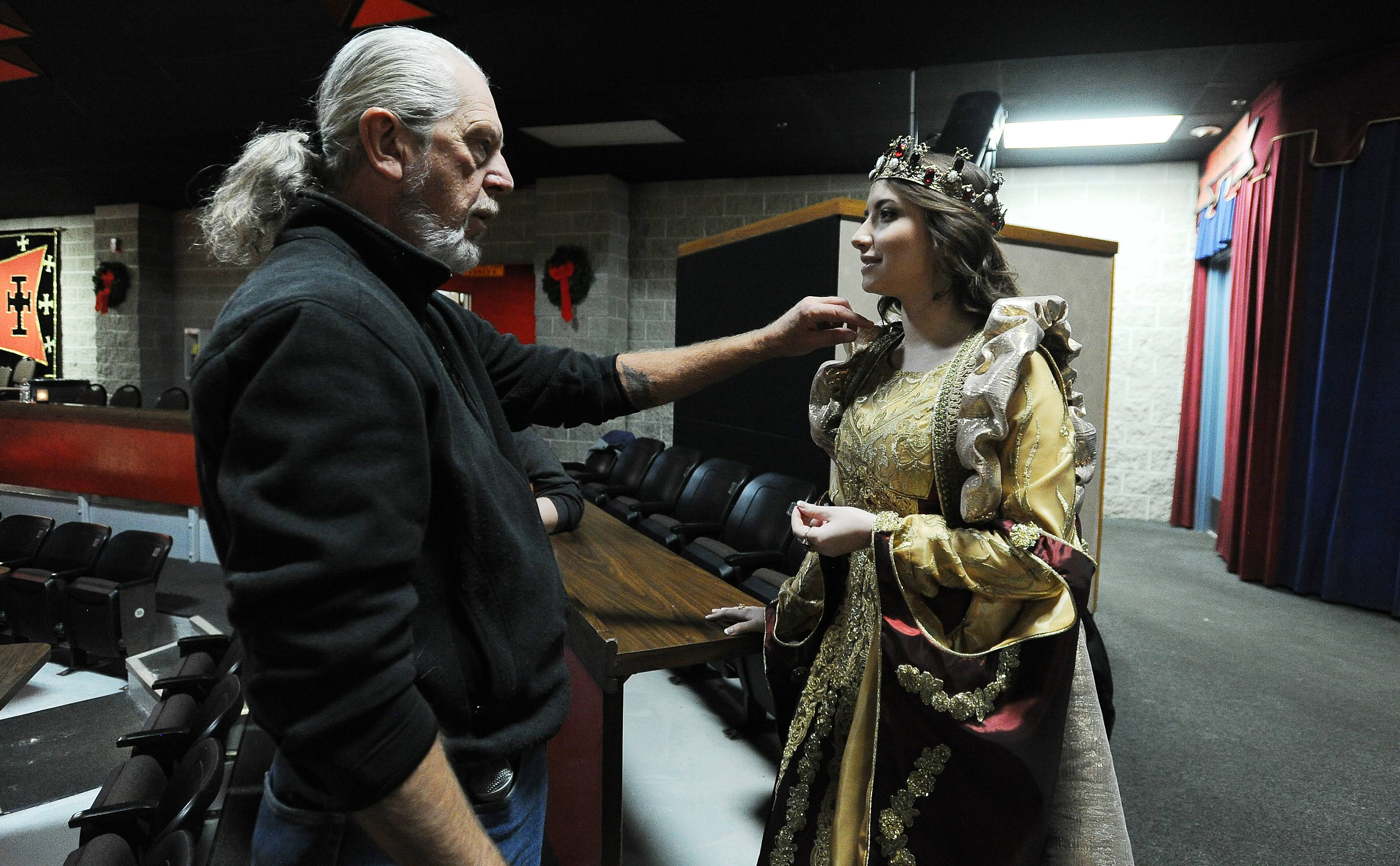 Director of show Leigh Cordner talks with Sara Schubring, one of the women sharing the role of ruling queen at Schaumburg's Medieval Times.