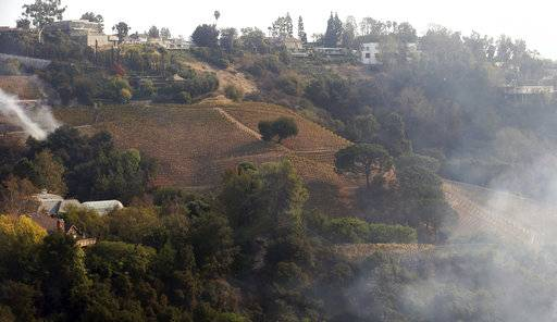 In this Dec. 6, 2017 photo, wildfire burns a portion of media mogul Rupert Murdoch's 16-acre (6.5-hectare) Moraga Vineyards estate, where about 7 acres (2.8 hectares) of vines appeared to have been damaged, a spokeswoman said.