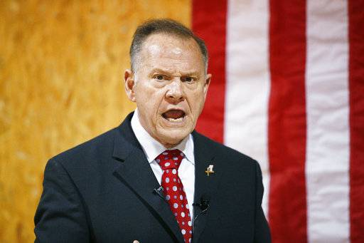 FILE- In this Nov. 30, 2017 file photo, former Alabama Chief Justice and U.S. Senate candidate Roy Moore speaks at a campaign rally, in Dora, Ala. In the Alabama Senate race, national Democrats and the liberal grassroots are treading lightly, trying not to sink Doug Jones' upset bid against Republican Roy Moore.