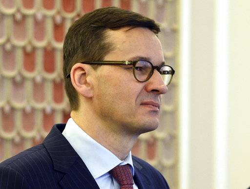 In this Dec. 5, 2017 photo Poland's Finance Minister, Mateusz Morawiecki, attends a cabinet meeting in Warsaw, Poland. Poland's conservative ruling party said Thursday, Dec. 7, 2017 that Polish Prime Minister, Beata Szydlo, has resigned and will be replaced by Morawiecki.