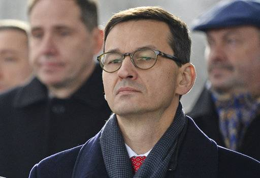 In this Nov. 11, 2017 photo Finance Minister Mateusz Morawiecki attends Independence Day celebrations in Warsaw, Poland, Saturday, Nov. 11, 2017. Poland's conservative ruling party said Thursday, Dec. 7, 2017, that Prime Minister, Beata Szydlo, has resigned and will be replaced by Finance Minister, Mateusz Morawiecki.
