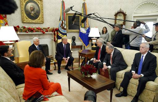 President Donald Trump accompanied by Vice President Mike Pence, speaks before a meeting with congressional leaders including House Speaker Paul Ryan of Wis., left, House Minority Leader Nancy Pelosi of Calif., Senate Majority Leader Mitch McConnell of Ky., Senate Minority Leader Chuck Schumer of N.Y., and Defense Secretary Jim Mattis, in the Oval Office of the White House, Thursday, Dec. 7, 2017, in Washington.
