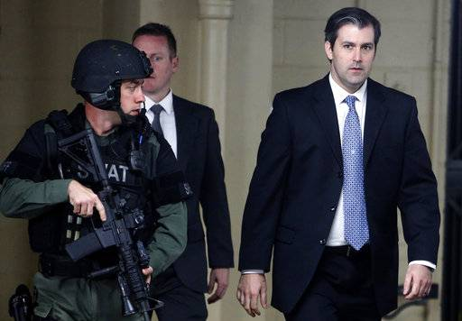 FILE - In this Monday, Dec. 5, 2016, file photo, former South Carolina officer, Michael Slager, right, walks from the Charleston County Courthouse under the protection of the Charleston County Sheriff's Department after a mistrial was declared for his trial in Charleston, S.C. Slager, who fatally shot a black motorist, Walter Scott, in 2015, could learn his fate as soon as his federal sentencing hearing winds down. On Thursday, Dec. 7, 2017, attorneys are expected to call friends and relatives of both men who'll tell the judge how Scott's death and the officer's arrest have impacted their lives.