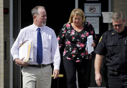 FILE- In this Sept. 1, 2017, file photo, Magisterial District Judge Allen Sinclair, left, leaves the Centre County Courthouse in Bellefonte, Pa. Sinclair threw out involuntary manslaughter and aggravated assault charges against eight defendants in death of Tim Piazza. A hearing on Thursday, Dec. 7, will determine whether a new district judge will preside over what will be a second preliminary hearing, as prosecutors pursue reinstated criminal charges in the death of Piazza. (John Boogert/Centre Daily Times via AP, File)