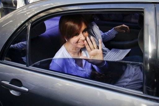 Argentina's former president, Sen. Cristina Fernandez waves to supporters as she leaves Congress, in Buenos Aires, Argentina, Thursday, Dec. 7, 2017. A federal judge on Thursday asked the Senate to allow the arrest of Fernandez on a charge of treason for allegedly covering up the role of Iranians in a 1994 bomb attack on a Jewish center.