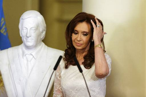 FILE - In this Dec. 9, 2015 file photo, Argentina's President Cristina Fernandez takes part in an unveiling a bust of her late husband, and former President Nestor Kirchner, at the presidential palace in Buenos Aires, Argentina. An Argentine federal judge on Thursday, Dec. 7, 2017, accused Fernandez of the crime of treason as he asked lawmakers to remove Fernandez's immunity from prosecution as a senator.