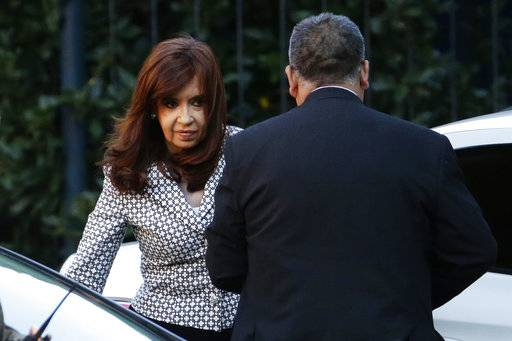 In this March 7, 2017 file photo, Argentina's former President Cristina Fernandez arrives for a court hearing, in Buenos Aires, Argentina. On Thursday, Dec. 7, 2017, a federal judge is asking Argentina's Senate to allow the arrest and trial of Fernandez for allegedly covering up the role of Iranians in a 1994 bomb attack on a Jewish center.