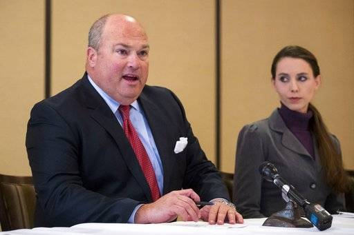 Attorney John Manly speaks during a press conference after Michigan sports doctor Larry Nassar was sentenced to 60 years in prison on child pornography charges in Grand Rapids, Mich., on Thursday, Dec. 7, 2017. Nassar was convicted of possessing child pornography and assaulting gymnasts. Manly is representing alleged victims of Nassar. (Mike Clark/The Grand Rapids Press via AP)