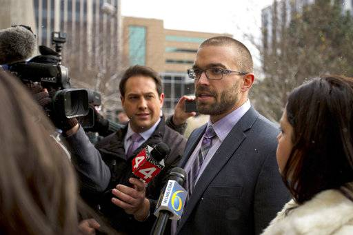 Larry Nassar's attorney Matt Newburg speaks to members of the media outside of the Gerald R. Ford Federal Building after Nassar was sentenced to 60 years in prison on child pornography charges in Grand Rapids, Mich., on Thursday, Dec. 7, 2017.  (Mike Clark/The Grand Rapids Press via AP)