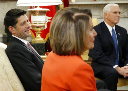 House Speaker Paul Ryan of Wis., left listens with House Minority Leader Nancy Pelosi of Calif., and Vice President Mike Pence during a meeting with President Donald Trump and congressional leaders in the Oval Office of the White House, Thursday, Dec. 7, 2017, in Washington.