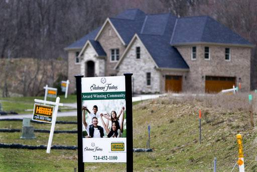 FILE - In this Monday, Feb. 27, 2017, file photo, real estate signs mark the lots near one of the new homes for sale in a development for new homes in Cranberry Township, Butler County, Pa. On Thursday, Dec. 7, 2017, Freddie Mac reports on the week's average U.S. mortgage rates.