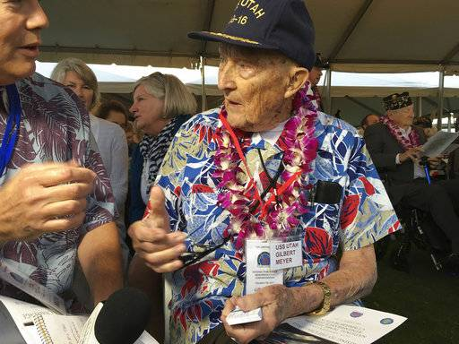 Pearl Harbor survivor Gilbert Meyer, 95, who lives near Lytle, Texas, speaks to a reporter before a remembrance ceremony at Pearl Harbor, Hi., on Thursday, Dec. 7, 2017.