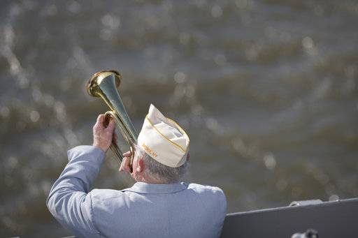 Vietnam veteran Jim Mullarkey plays taps on his bugle during a ceremony commemorating the 76th anniversary of the Dec. 7, 1941 Japanese attack on Pearl Harbor, Thursday, Dec. 7, 2017, on board the Intrepid Sea, Air & Space Museum in New York.