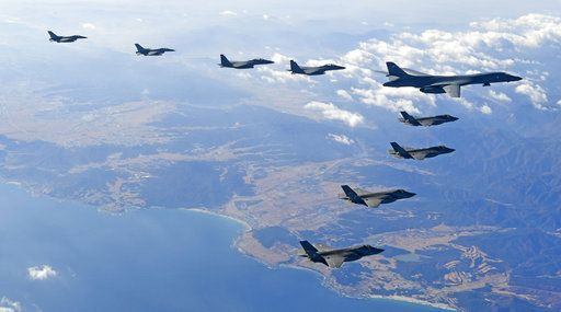 In this photo provided by South Korea Defense Ministry, U.S. Air Force B-1B bomber, right top, flies over the Korean Peninsula with South Korean fighter jets and U.S. fighter jets during the combined aerial exercise, South Korea, Wednesday, Dec. 6, 2017. The United States flew a B-1B supersonic bomber over South Korea on Wednesday in part of a massive combined aerial exercise involving hundreds of warplanes, a clear warning after North Korea last week tested its biggest and most powerful missile yet. (South Korea Defense Ministry via AP)