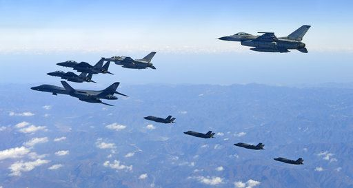 In this photo provided by South Korea Defense Ministry, U.S. Air Force B-1B bomber, far left, South Korea and U.S. fighter jets fly over the Korean Peninsula during the combined aerial exercise, South Korea, Wednesday, Dec. 6, 2017. The United States flew a B-1B supersonic bomber over South Korea on Wednesday in part of a massive combined aerial exercise involving hundreds of warplanes, a clear warning after North Korea last week tested its biggest and most powerful missile yet. (South Korea Defense Ministry via AP)