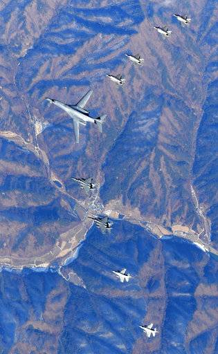 In this photo provided by South Korea Defense Ministry, U.S. Air Force B-1B bomber, center, flies over the Korean Peninsula with South Korean fighter jets F-16, F-15K and U.S. fighter jets F-35A, F35B during their combined aerial exercise Wednesday, Dec. 6, 2017. The United States flew a B-1B supersonic bomber over South Korea on Wednesday as part of a massive combined aerial exercise involving hundreds of warplanes, a clear warning after North Korea last week tested its biggest and most powerful missile yet. (South Korea Defense Ministry via AP)