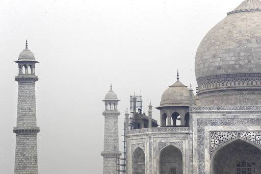 In this Tuesday, Dec. 5, 2017, photo, Indian workers clean the discoloration of the Taj Mahal caused by environmental pollution in Agra, India. Authorities in India are trying to figure out how workers will scale the Taj Mahal's majestic but delicate dome as they complete the first thorough cleaning of the World Heritage site since it was built 369 years ago. Work on the mausoleum's minarets and walls is almost finished, after workers began the makeover in mid-2015. They've been using a natural mud paste to remove yellow discoloration and return the marble to its original brilliant white. Called fuller's earth, it's the same clay that some people smother on their skin as a beauty treatment.