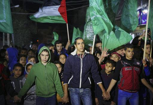 Hamas supporters wave their green flags during a protest against the possible U.S. decision to recognize Jerusalem as Israel's capital, in Jebaliya Refugee Camp, Gaza Strip, Wednesday, Dec. 6, 2017. President Donald Trump is forging ahead with plans to recognize Jerusalem as Israel's capital despite intense Arab, Muslim and European opposition to a move that would upend decades of U.S. policy and risk potentially violent protests.