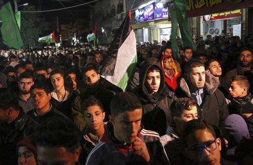 Hamas supporters stage a protest against the possible U.S. decision to recognize Jerusalem as Israel's capital, in Jebaliya Refugee Camp, Gaza Strip, Wednesday, Dec. 6, 2017. President Donald Trump is forging ahead with plans to recognize Jerusalem as Israel's capital despite intense Arab, Muslim and European opposition to a move that would upend decades of U.S. policy and risk potentially violent protests.
