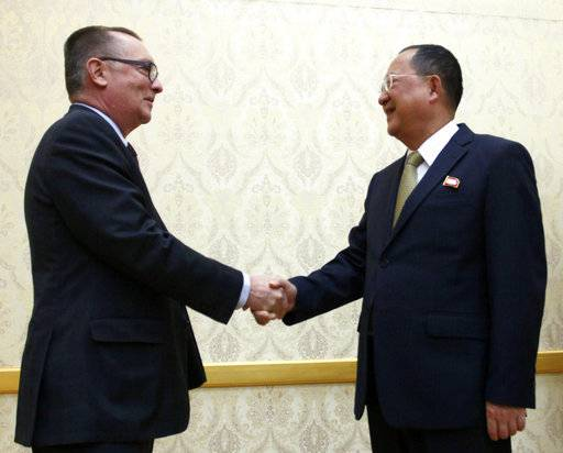 North Korean Foreign Minister Ri Yong Ho, right, and U.N. undersecretary-general for political affairs Jeffrey Feltman shake hands at the Mansudae Assembly Hall in Pyongyang, North Korea Thursday, Dec. 7, 2017. The senior United Nations official is on a four-day visit to the country at the invitation of the North Korean government.