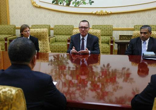 U.N. undersecretary-general for political affairs Jeffrey Feltman, center, meets with North Korean Foreign Minister Ri Yong Ho at the Mansudae Assembly Hall in Pyongyang, North Korea Thursday, Dec. 7, 2017. The senior United Nations official is on a four-day visit to the country at the invitation of the North Korean government.