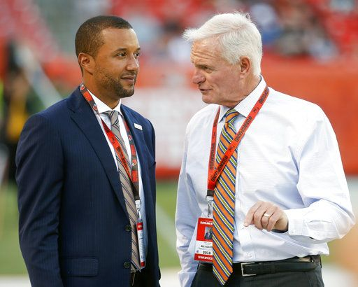 FILE - In this Aug. 18, 2016, file photo, Sashi Brown, acting executive vice president of football operations for the Cleveland Browns, left, speaks with Browns' owner Jimmy Haslam during practice before an NFL preseason football game against the Atlanta Falcons, in Cleveland. A person familiar with the decisions says the Cleveland Browns have fired Sashi Brown, the club's vice president of football operations. Brown, who was named the team's top executive by owners Dee and Jimmy Haslam during an overhaul following the 2015 season, was relieved of his duties on Thursday, Dec. 7, 2017, said the person who spoke to the Associated Press on condition of anonymity because the team has not announced the move.
