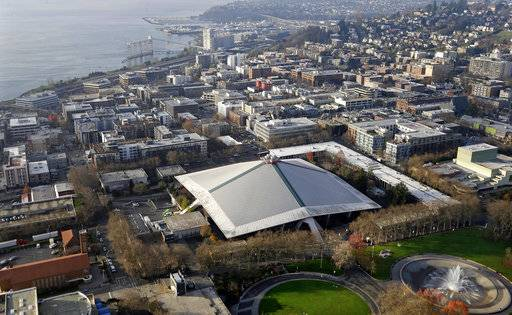 The iconic sloped roof of KeyArena, center, a sports and entertainment venue at the Seattle Center, is seen from above Monday, Dec. 4, 2017, in Seattle. The Seattle City Council on Monday approved a memorandum of understanding with Los Angeles-based Oak View Group in a $600 million privately financed project to renovate the facility, formerly the home of the NBA's SuperSonics.