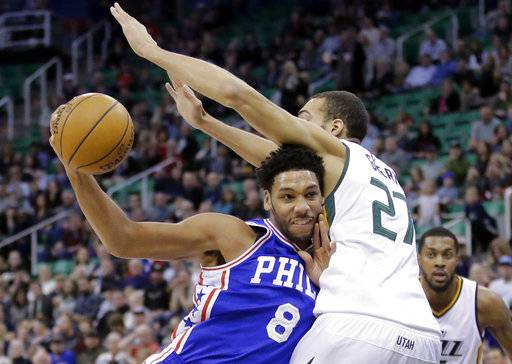 FILE - In this Dec. 29, 2016, file photo, Philadelphia 76ers center Jahlil Okafor (8) drives to the basket as Utah Jazz center Rudy Gobert (27) defends in the first half during an NBA basketball game in Salt Lake City. A person familiar with the deal says 76ers are set to trade beleaguered center Okafor to the Brooklyn Nets.