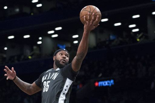 FILE - In this Dec. 2, 2017, file photo, Brooklyn Nets forward Trevor Booker (35) goes to the basket during the first half of an NBA basketball game against the Atlanta Hawks in New York. A person familiar with the deal says the Philadelphia 76ers are set to trade beleaguered center Jahlil Okafor to the Nets along with guard Nik Stauskas and a 2019 second-round draft pick for forward Booker.