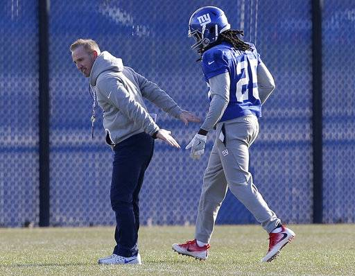 New York Giants interim head coach Steve Spagnuolo, left, works with Brandon Dixon during an NFL football practice in East Rutherford, N.J., Wednesday, Dec. 6, 2017.