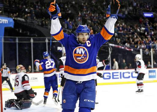 FILE - In this Oct. 24, 2017, file photo, New York Islanders' John Tavares (91) celebrates after scoring a goal against Arizona Coyotes goalie Louis Domingue (35) during the second period of an NHL hockey game in New York. Through the first two months of the season, goals are up more than 12 percent from the same time a year ago, including a 14 percent increase on the power play and a 38 percent spike short-handed.