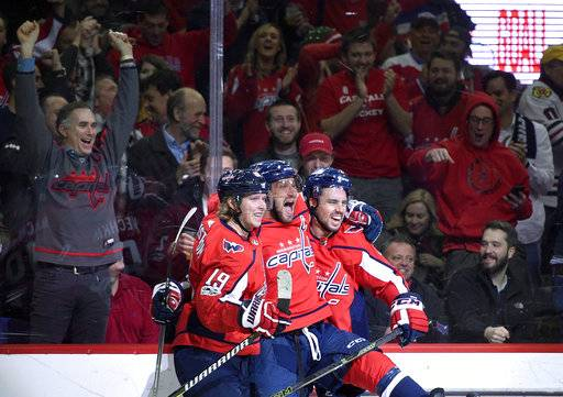 FILE - In this Wednesday, Dec. 6, 2017, file photo, Washington Capitals left wing Alex Ovechkin, center, of Russia, celebrates his goal with center Nicklas Backstrom (19), of Sweden, and defenseman Matt Niskanen, right, during the first period of an NHL hockey game against the Chicago Blackhawks in Washington. Through the first two months of the season, goals are up more than 12 percent from the same time a year ago, including a 14 percent increase on the power play and a 38 percent spike short-handed.